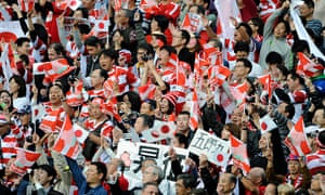 Japanese fans celebrate a famous victory in the Rugby World Cup against South Africa in Brighton
