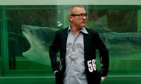Damien Hirst with his work Death Explained