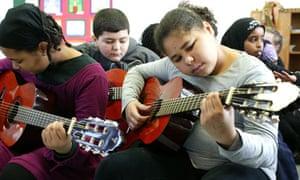Guitar lesson in a school