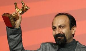 Asghar Farhadi poses with Golden Bear prize at Berlin Film Festival