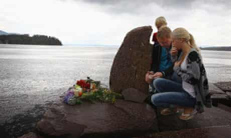 People pay their respects near Utoya island, Norway
