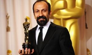 Asghar Farhadi with his Oscar for best foreign language film