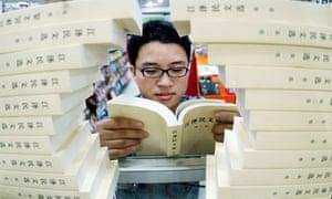 A reader in a bookshop in Fuzhou in southeast China's Fujian province