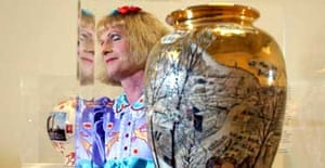 2003 Turner Prize winner Grayson Perry with one of his vases