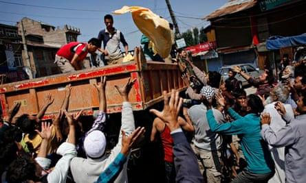 Volunteers in Srinagar hand out supplies