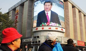 A screen at a Beijing junction shows a speech by Xi Jinping, new head of the Communist party