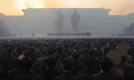 North Koreans watch fireworks as statues of Kim Jong-Il and Kim Il-Sung are unveiled in Pyongyang