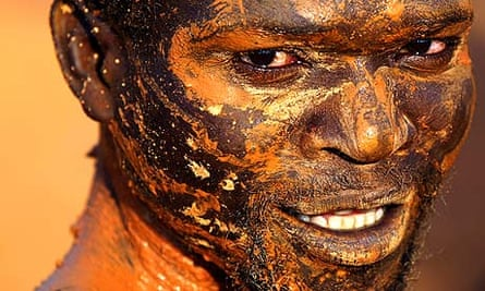 A Mozambican gold miner prepares to climb down into a mine shaft in Manica province