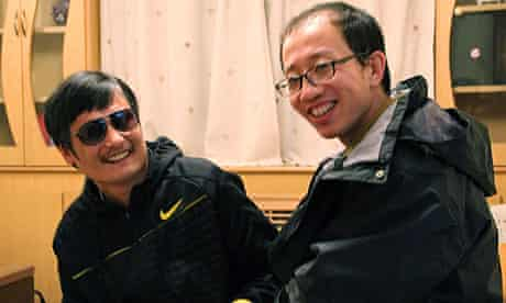 blind Chinese legal activist Chen Guangcheng and friend and fellow activist Hu Jia in April 2012