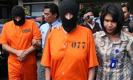 alleged British drug smugglers Suspects are escorted by Indonesian police officers in Denpasar