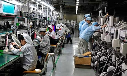 A Foxconn factory in Shenzhen. The workers are only allowed to sit down if they perch on the seat