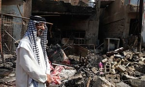A man stands at the scene of a bomb attack in Madain, near Baghdad.