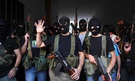 Shia masked gunmen from the Meqdad clan gather in the southern suburbs in Beirut