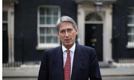 Philip Hammond, defence secretary, speaks to reporters after joint Isaf/Afghan patrols were halted