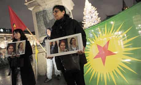 Kurds at a demonstration in Strasbourg hold photos of three Kurdish activists shot dead in Paris.