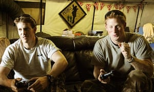 Prince Harry plays a video game at Camp Bastion, Afghanistan