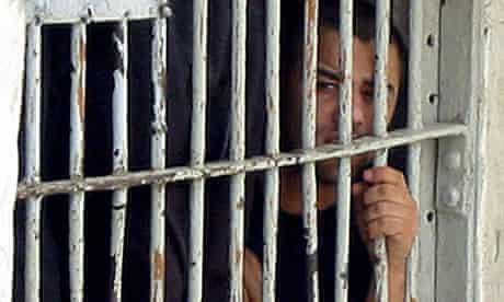 An Iraqi detainee of the British military in al-Ma'aqal prison, Basra, in  2004.