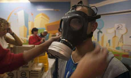 An Israeli man has a gas mask fitted at a distribution centre in East Jerusalem