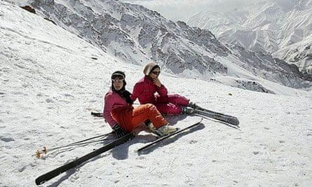 Iranian girls take a break from skiing at Shemshak, about 35 miles from Tehran.