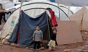 Syrian children near their tent at a refugee camp in the Lebanese border town of Arsal