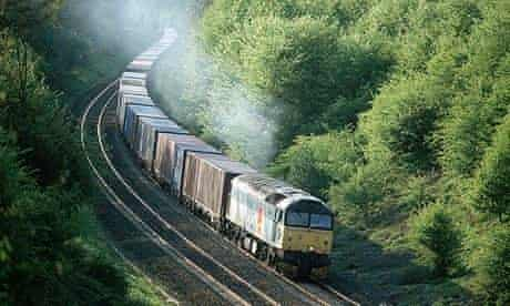 A locomotive pulls containers through Warwickshire.