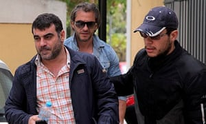 Greek journalist Kostas Vaxevanis, left, after his arrest for leaking the 'Lagarde list'