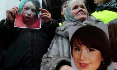 Ukrainian portesters hold photos of journalist and activist Tetyana Chernovil at a rally in Kiev.