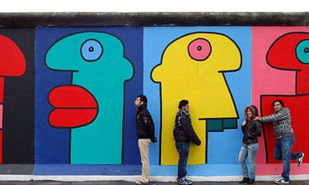 Berlin Wall murals by French artist Thierry Noir who joined protesters fighting to preserve the wall