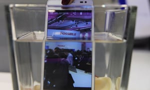A new smartphone Ascend D2 by Huawei is plunged into water at the Mobile World Congress in Barcelona