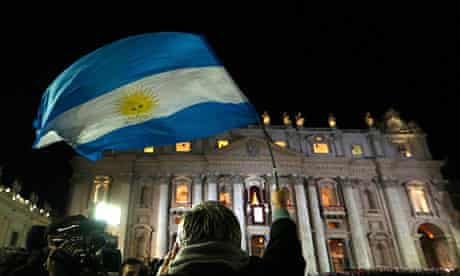 A pilgrim in St Peter's basilica waves an Argentine flag as the first Latin American pope is elected