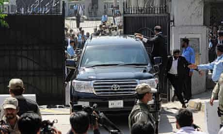Pakistan's ex-military ruler Pervez Musharraf leaves the high court in Islamabad