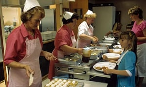 Dinner ladies serving lunch at a school in Derby.