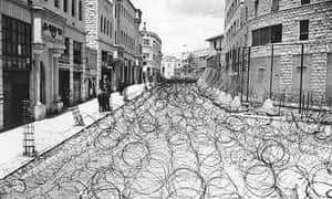 Barbed wire to separate Arabs and Jews covers Princess Mary Avenue in Jerusalem in May 1948