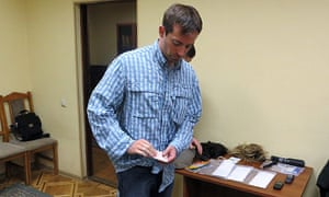 Ryan Fogle after his arrest by the FSB, with items he was said to be carrying, such as wigs, cash