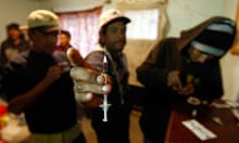 Addicts prepare to inject heroin at a drug den in Ciudad Juárez. Numbers of drug users have soared