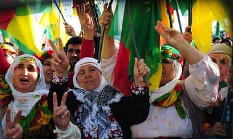 Kurdish women wave PKK flags as they celebrate Nowruz, the Persian new year.