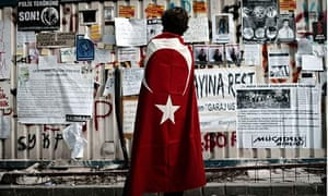 A Taksim Square protester reads leaflets in Istanbul