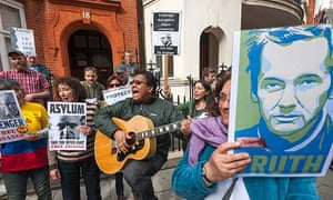 Julian Assange's supporters at the Ecuadorean embassy on the anniversary of him taking refuge there
