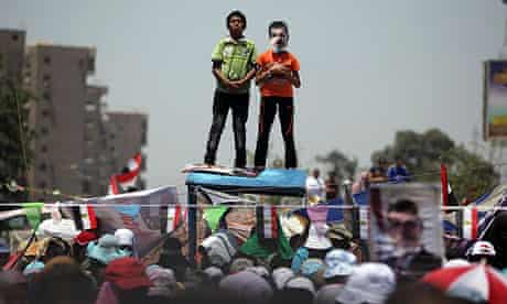 Supporters of Mohammed Morsi protest at Nasr City, Cairo.