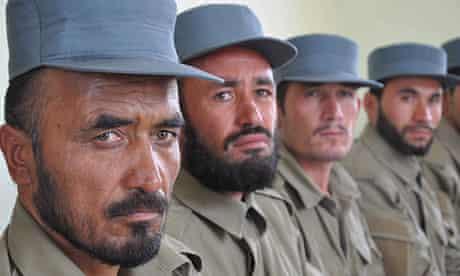Afghan policemen attend their graduation ceremony in Afghanistan's Jawzjan province.