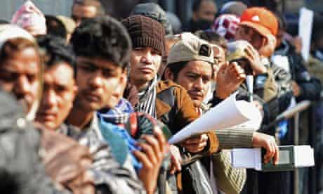Nepalese migrant workers queue in Kathmandu for documents to leave Nepal.