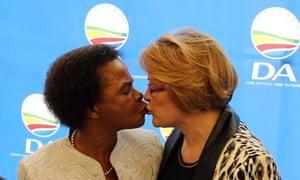 anti-apartheid activist Mamphela Ramphele, left, greets Helen Zille, head of the Democratic Alliance