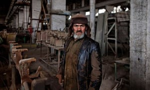 worker at the Kabul House Building Factory