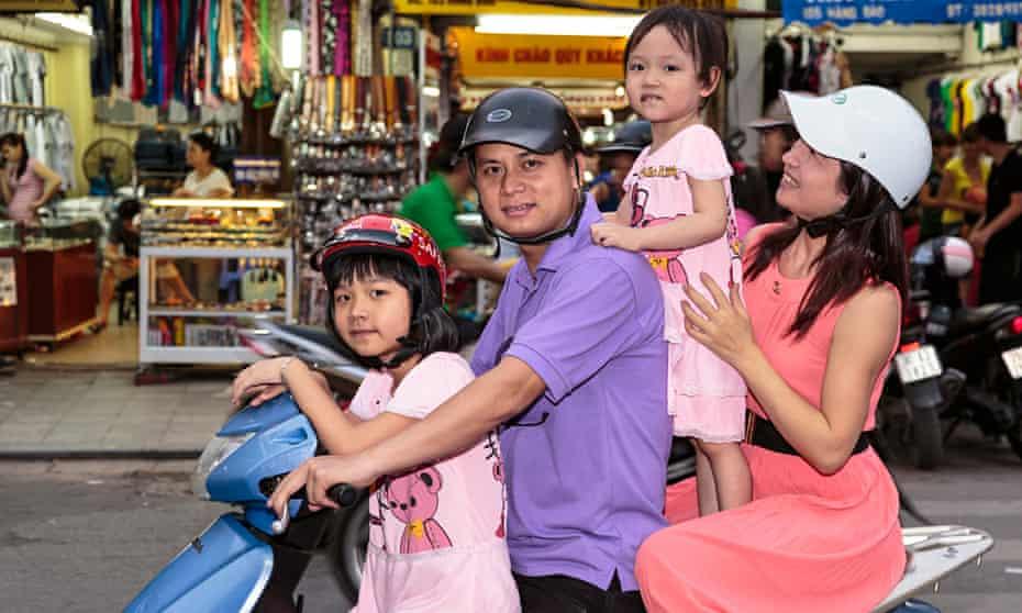 Family on motorbike in Hanoi
