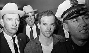 Lee Harvey Oswald Being Led by Policemen
