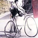 Stressed photograph, Boy on bike, circa 1950  by Nigel Henderson
