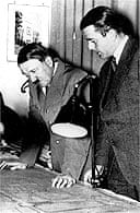 Adolf Hitler and Albert Speer studying building plans