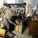 Civilians inspect Torah scrolls stored in the vault of the National Museum in Baghdad