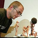 Dinos Chapman with some of the penis-nosed chess pieces