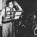 Orson Welles recording the famous 1938 radio drama based on HG Wells's War of the Worlds